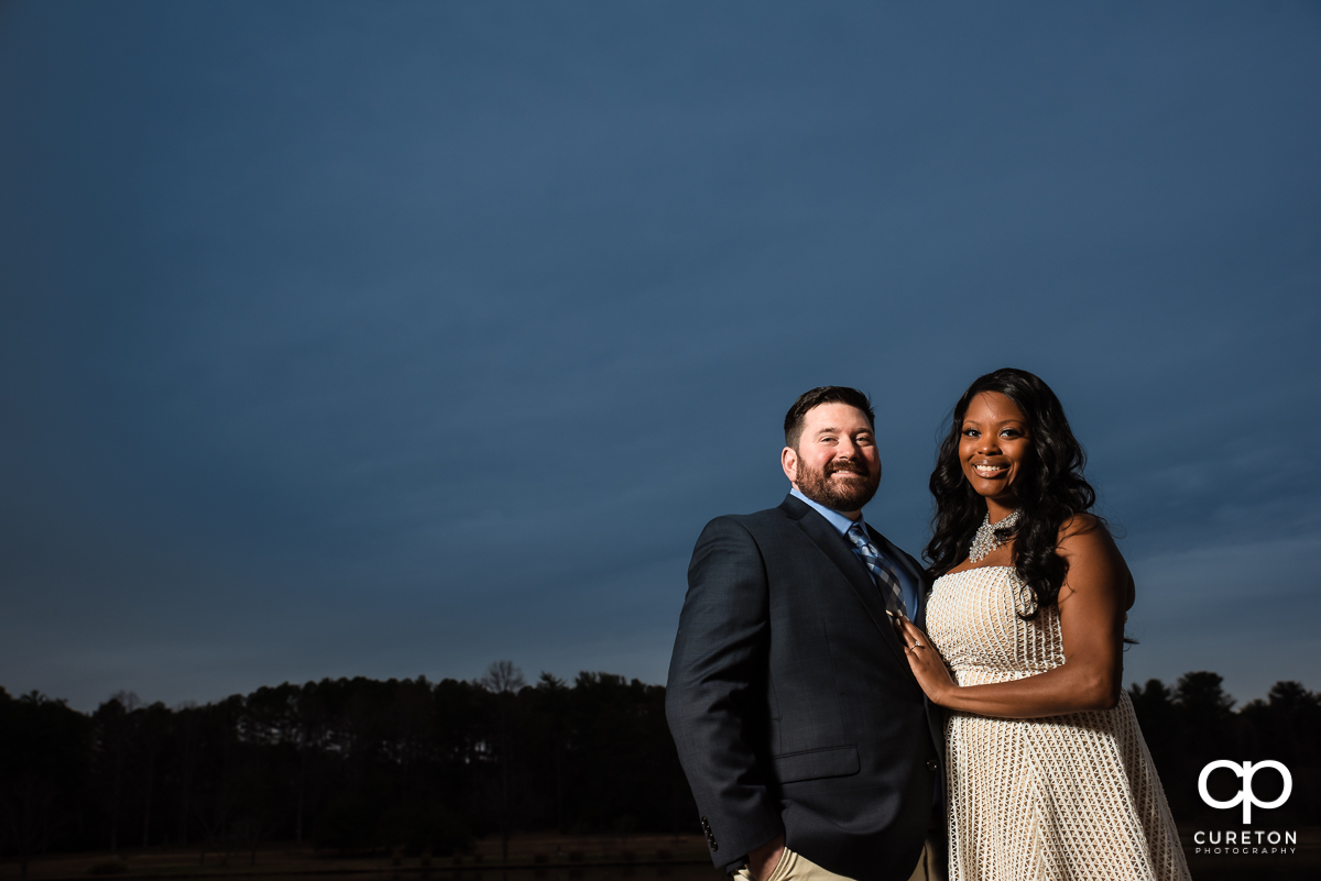 Engaged couple at sunset.