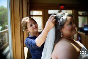 Bride's mother putting in her veil.