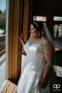 Bride looking out of the window.