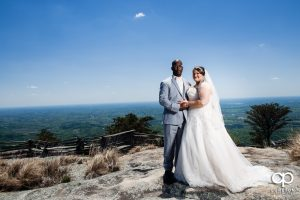 Bride and groom on a mountain top.
