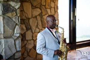 Groom playing the saxophone at the ceremony.