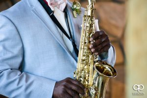 Groom playing a saxophone.