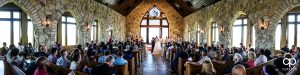 Wide panorama of a wedding ceremony at Cliffs Glassy Chapel.