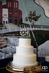 Wedding cake with custom ferris wheel topper.
