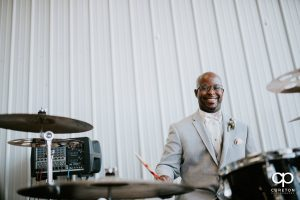 Groom playing drums at the reception.