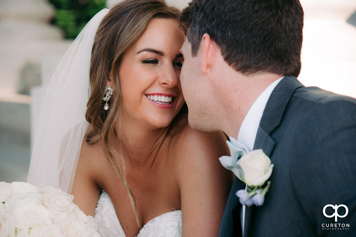 Bride and groom cuddling after their wedding at Grace Church in Greenville,SC.