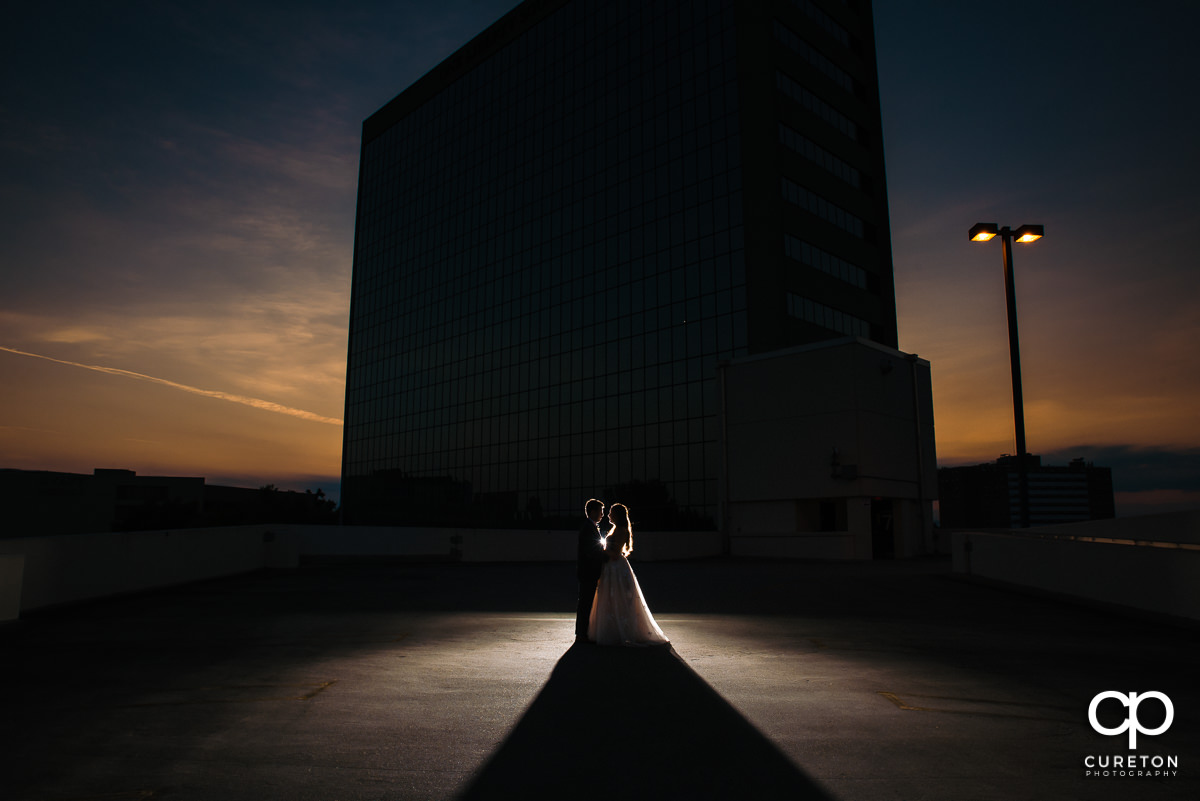 Bride and Groom dancing on a rooftop at sunset at their Commerce Club Wedding in Greenville,SC.