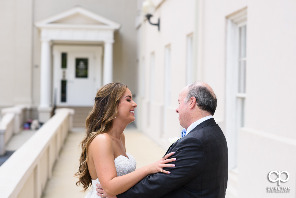 Bride and father share a first look before the wedding at Grace Church in Greenville,SC.