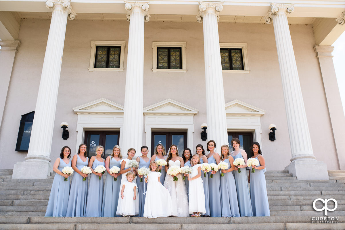 Bride and bridesmaids on the steps before the wedding at Grace Church in Greenville,SC.