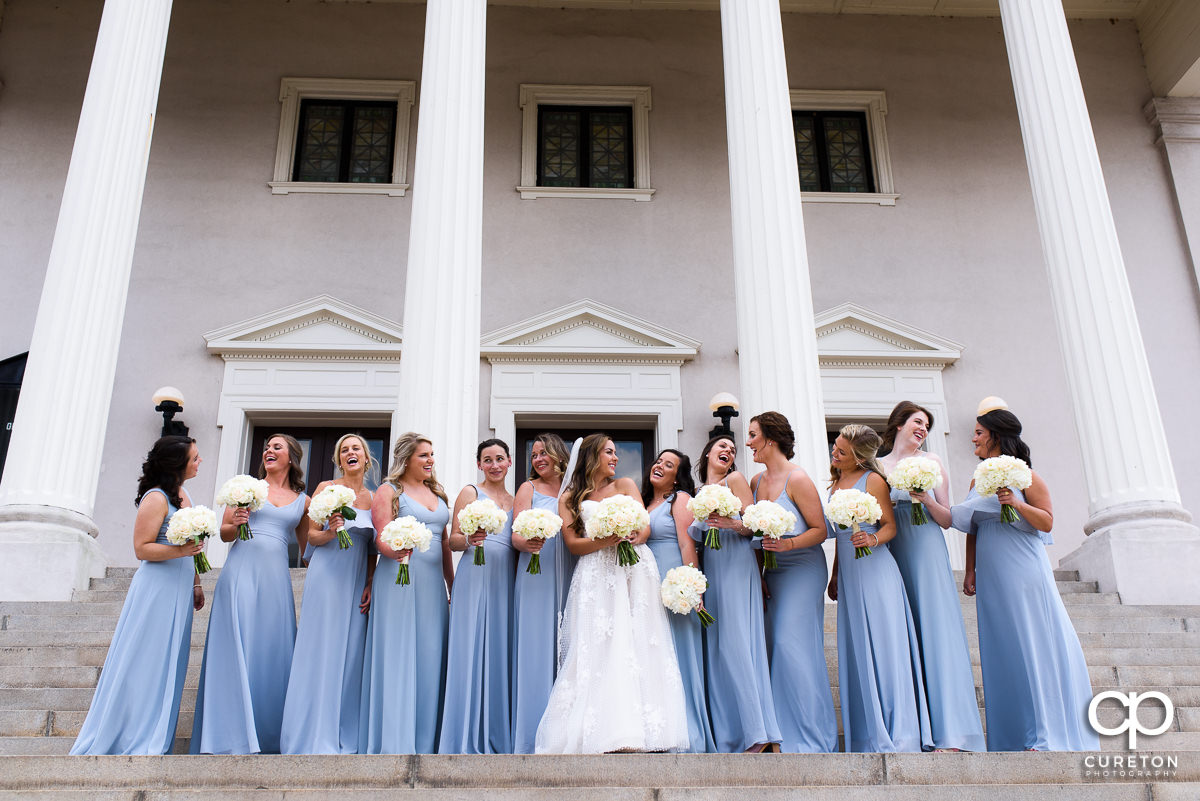 Bride laughing with her bridesmaids moments before the wedding at Grace Church in Greenville,SC.