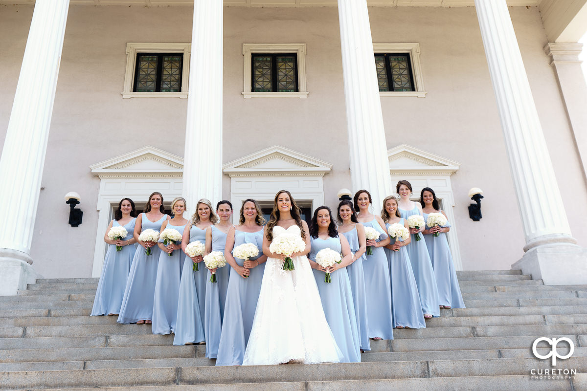 Bride and her bridesmaids posing on the steps before the wedding at Grace Church in Greenville,SC.