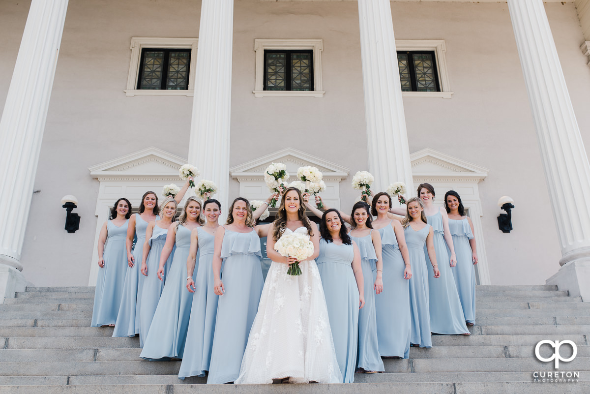 Bride and her bridesmaids on the steps of Grace Church in Greenville.
