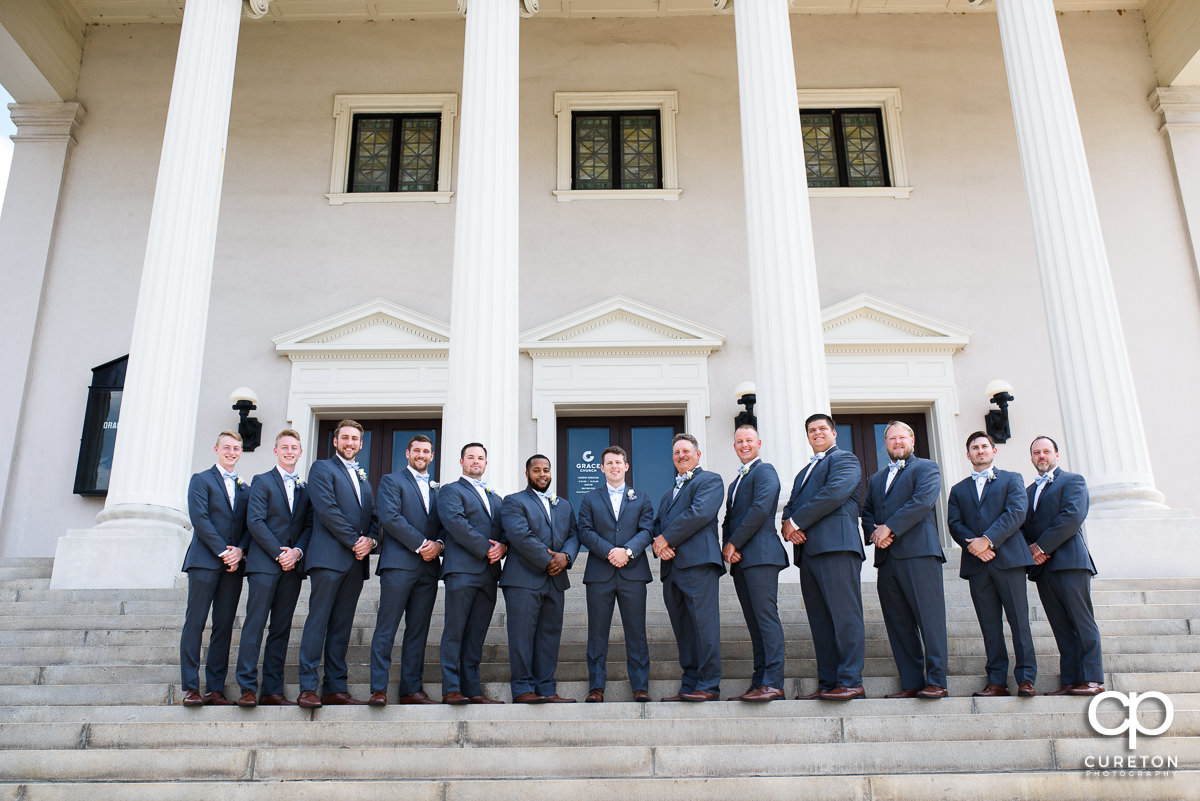 Groom and groomsmen on the steps before the wedding at Grace Church in Greenville,SC.