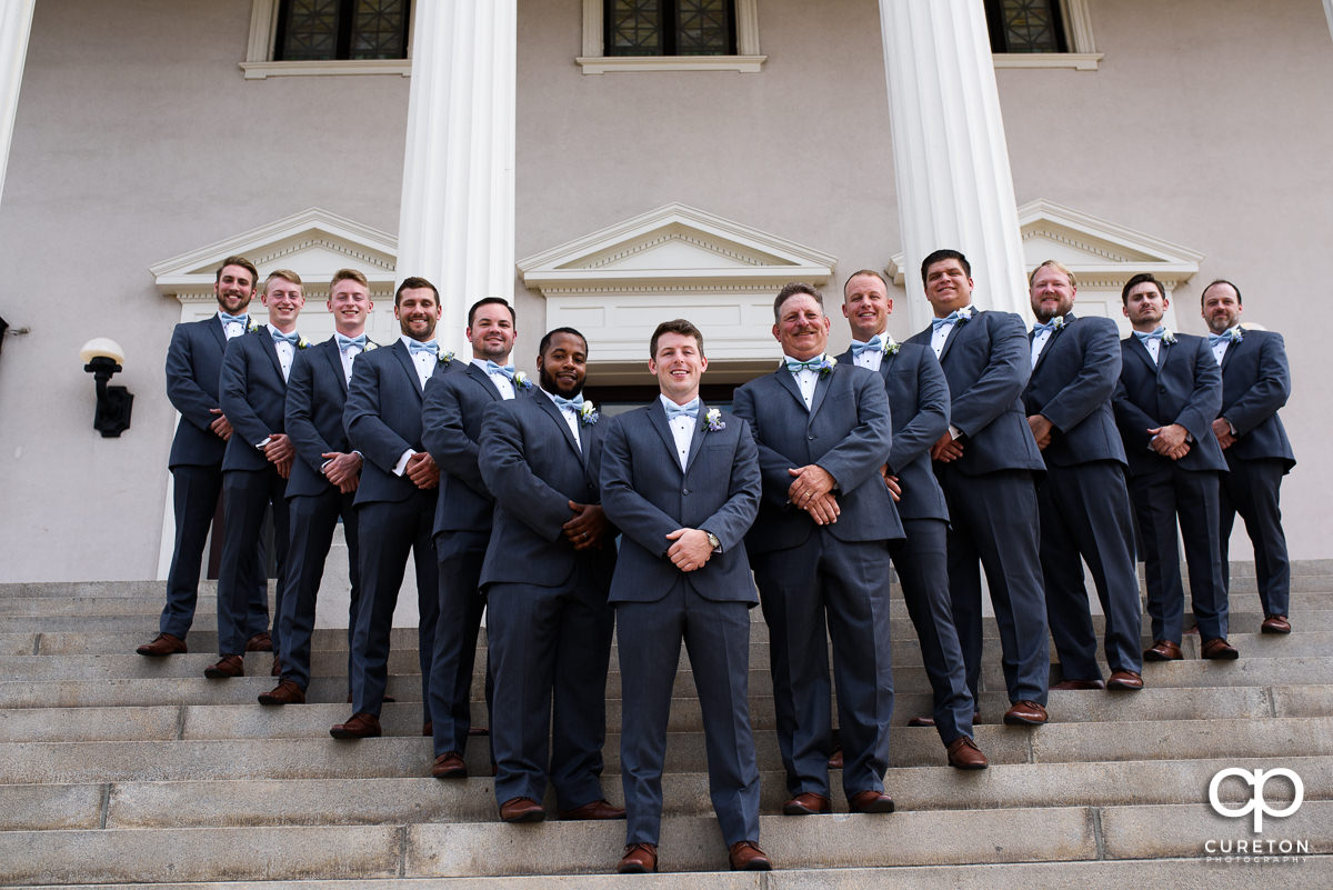 Groom and his groomsmen posing on the steps before the wedding at Grace Church in Greenville,SC.