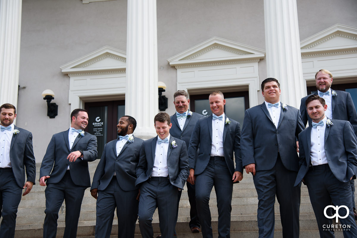 Groom laughing with his groomsmen.