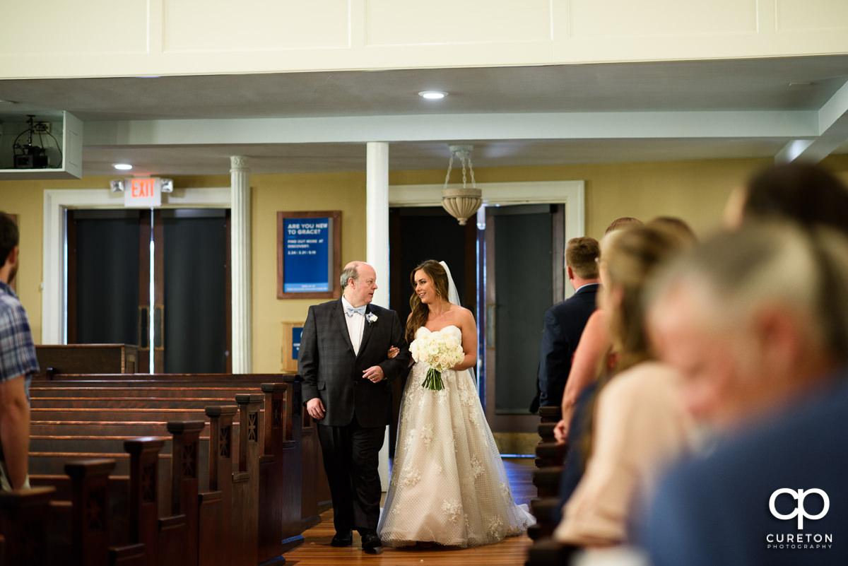 Bride and her father walking down the aisle at the Grace Church wedding.