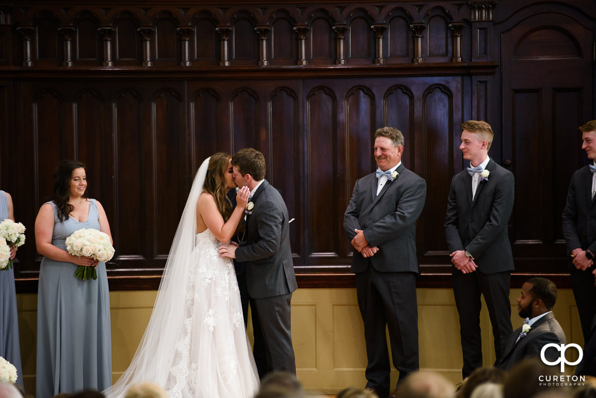 First kiss at teh wedding at Grace Church in Greenville,SC.