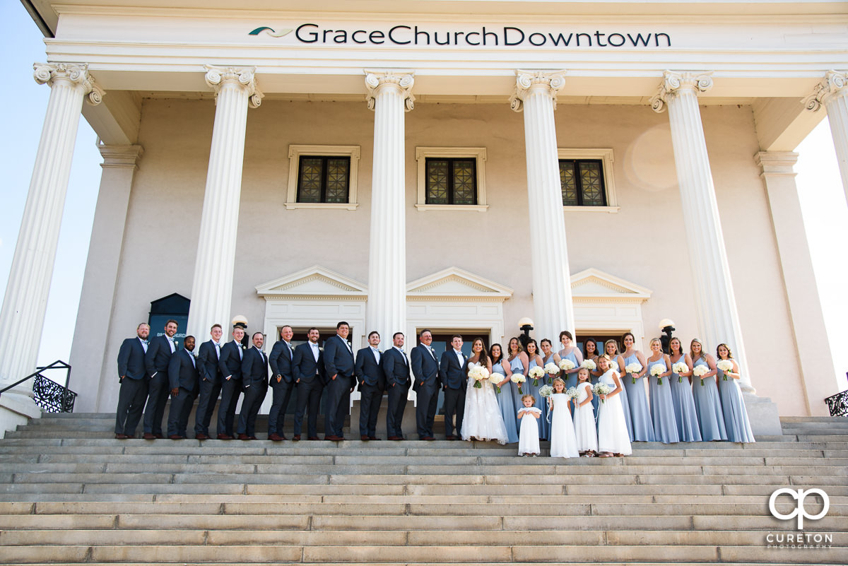 Wedding party on the steps at the wedding at Grace Church in Greenville,SC.