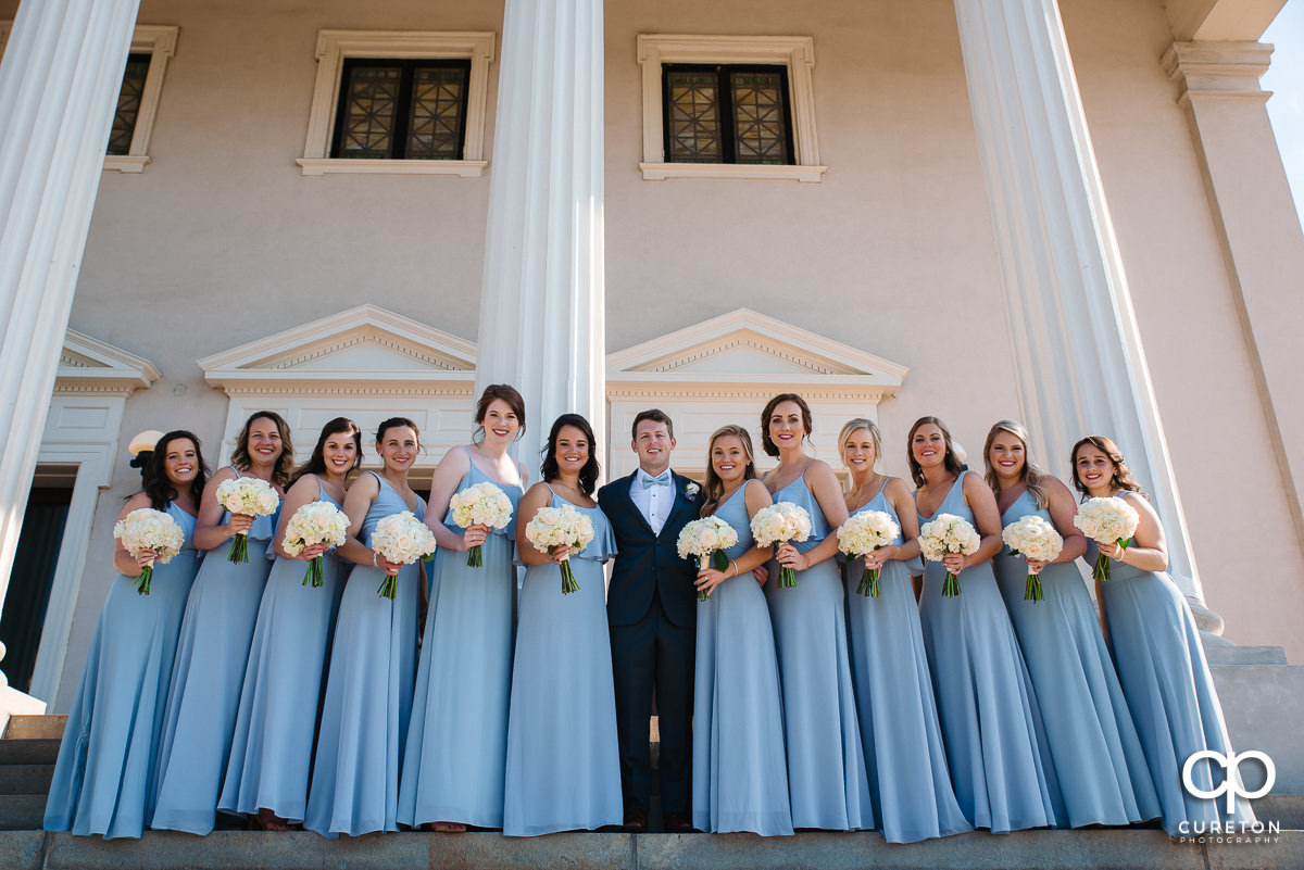 Groom with the bridesmaids.