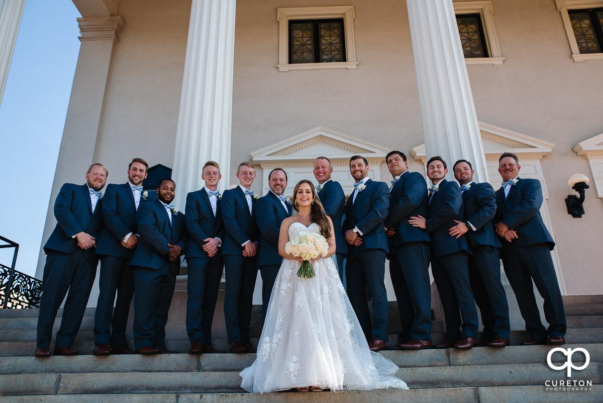 Bride with the groomsmen.