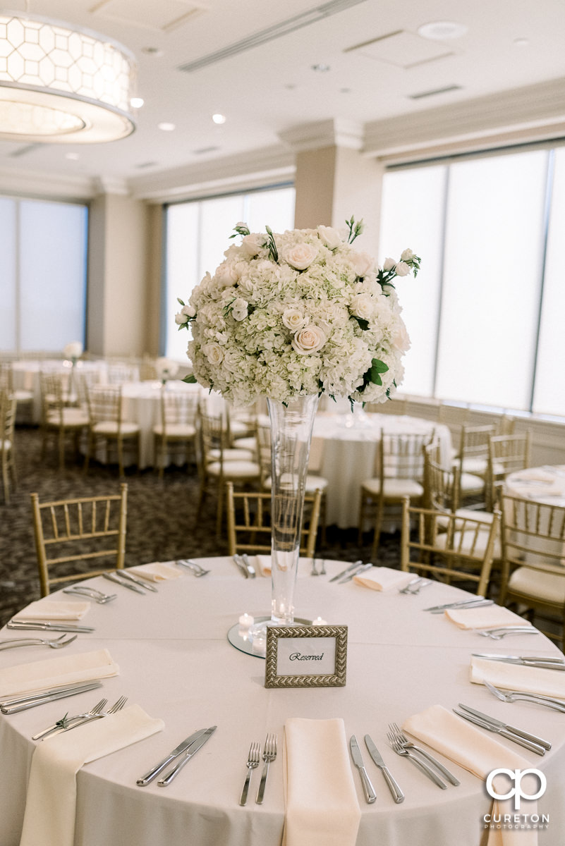 Tables set with flowers at the Commerce Club wedding reception in Greenville,SC.