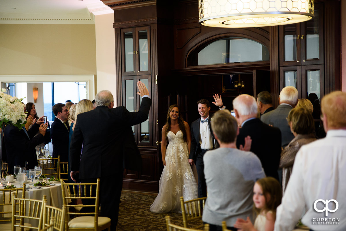 Bride and groom making the entrance at the Commerce Club wedding reception in Greenville,SC.