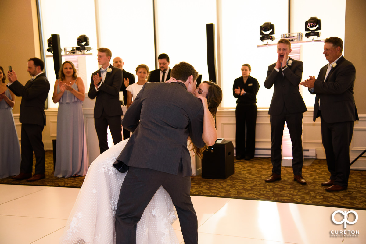 Groom dipping the bride on the dance floor at the Commerce Club wedding reception in Greenville,SC.