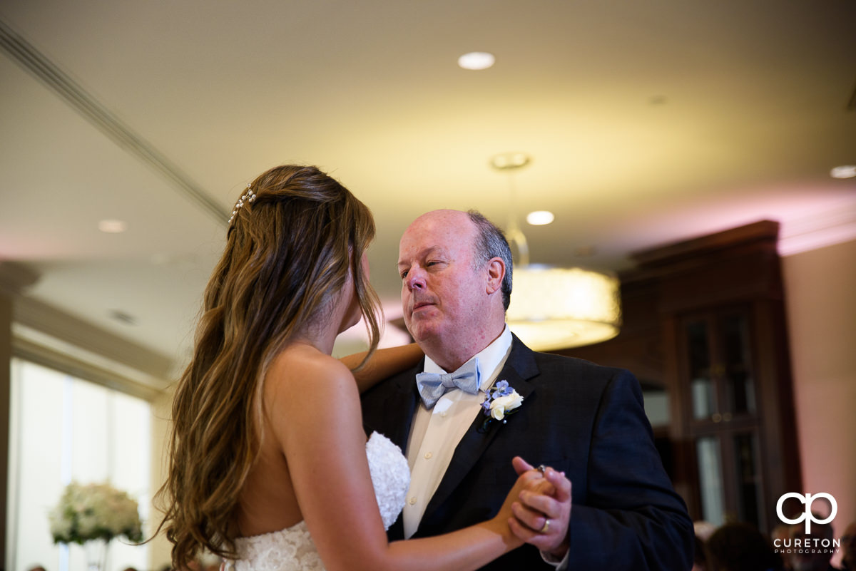 Bride dancing with her dad at the Commerce Club wedding reception in Greenville,SC.