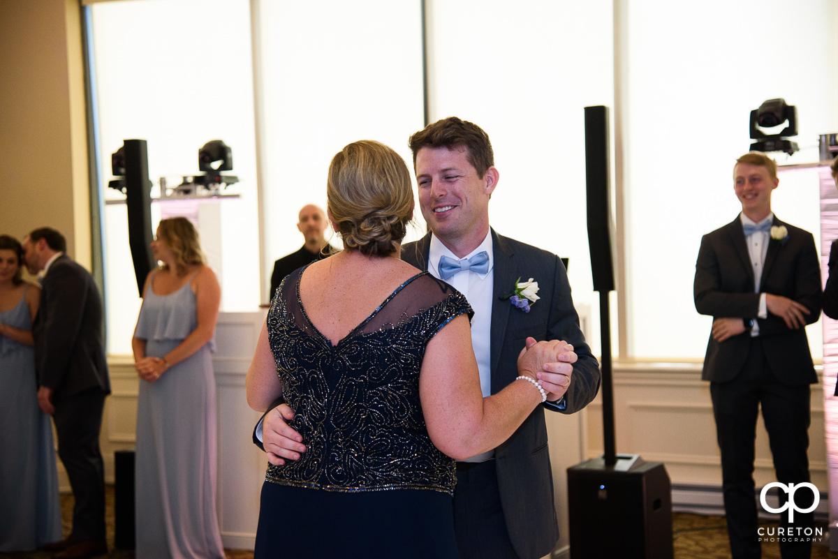 Groom sharing a dance with his mom at the Commerce Club wedding reception in Greenville,SC.