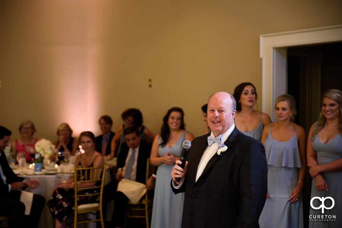 Bride's father giving a speech.