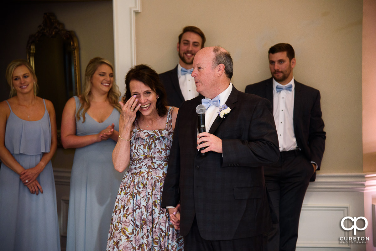 Bride's mom tearing up as her husband gives a speech at the Commerce Club wedding reception in Greenville,SC.