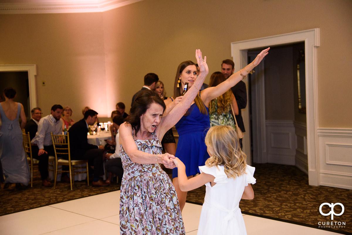 Bride's mom dancing.