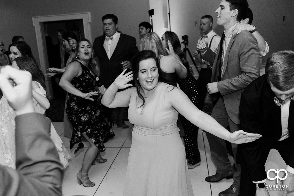 Guests dancing at a Commerce Club wedding reception.