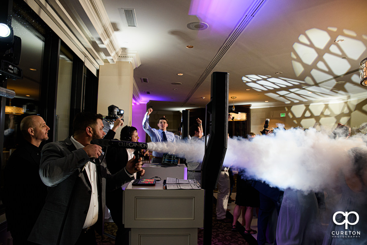 DJ Justin Reid from Uptown Entertainment firing a Club Cannon at a wedding reception in Greenville.