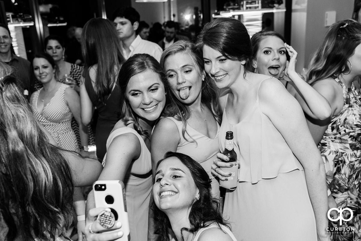 Bridesmaids taking a selfie.