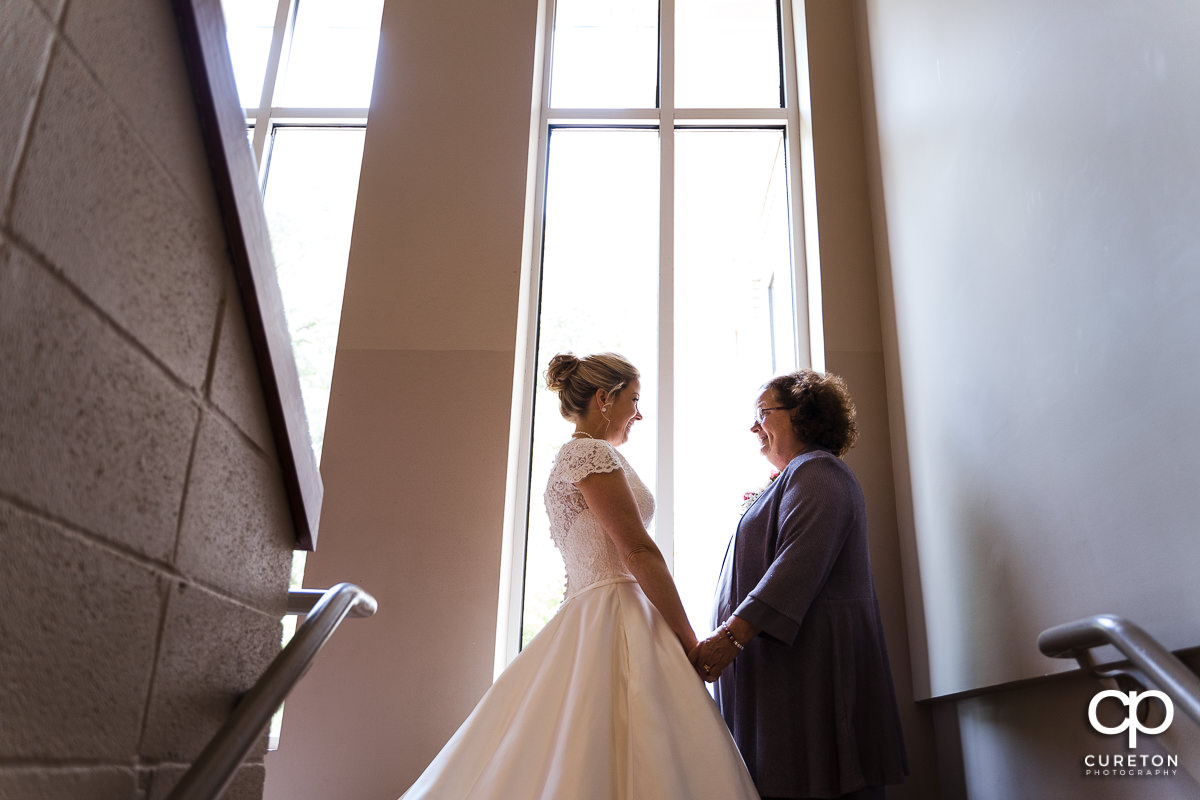 Bride and her mother sharing a moment before the ceremony.