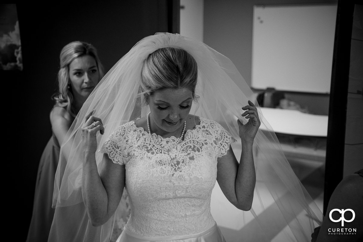 Bride putting her veil in.