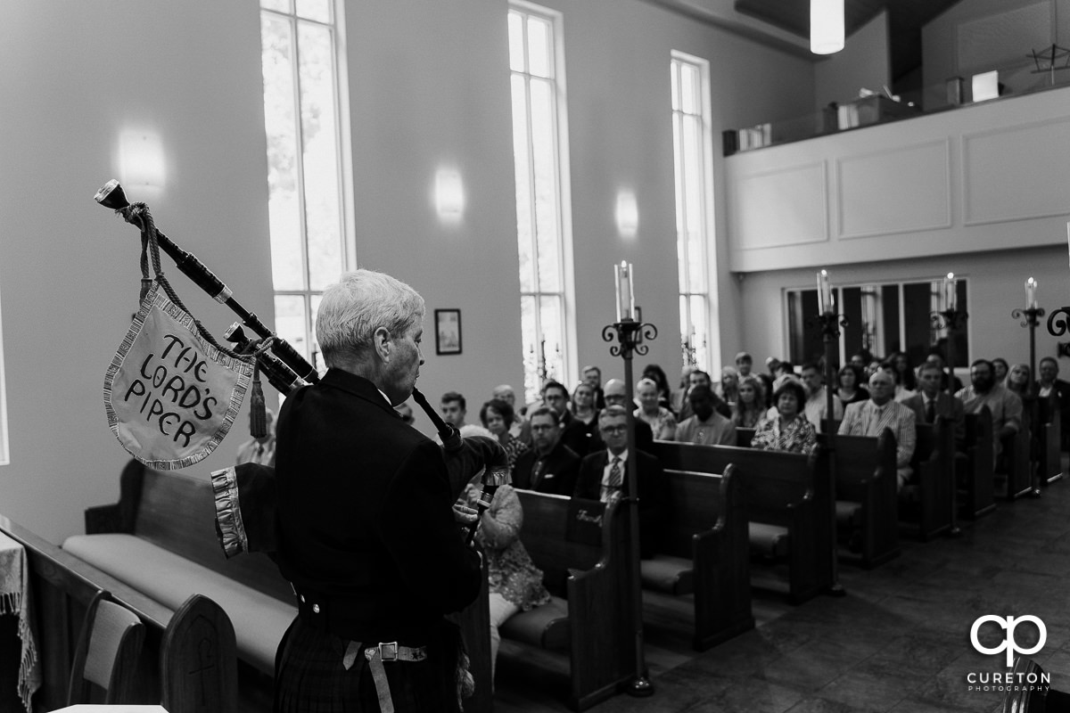 Bagpiper playing at the wedding ceremony.