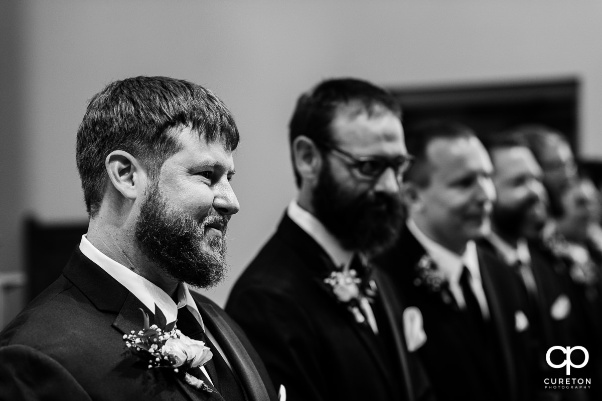 Groom seeing his bride for the first time.