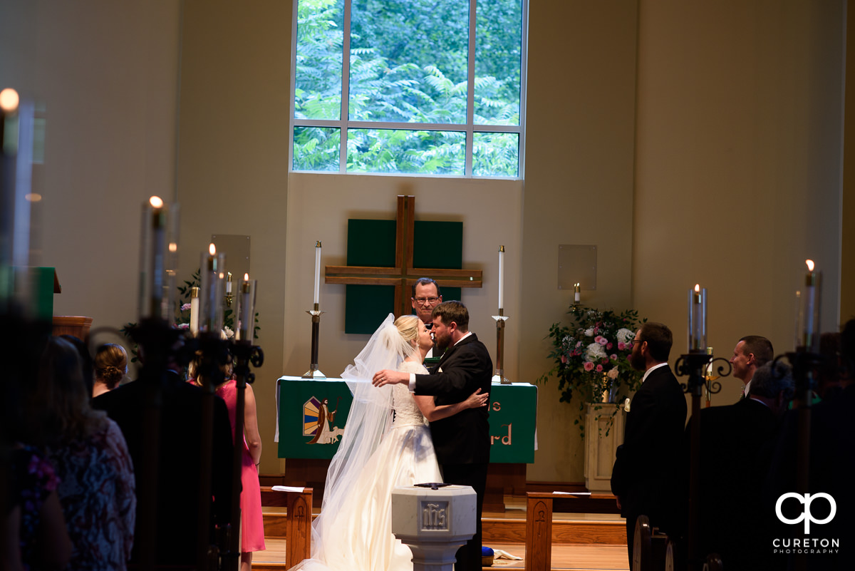 First kiss at the church wedding ceremony.