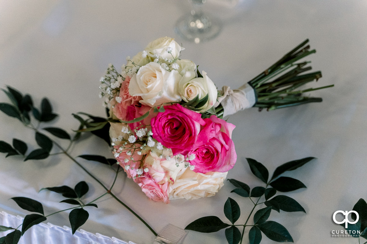 Florals on the table at the reception.