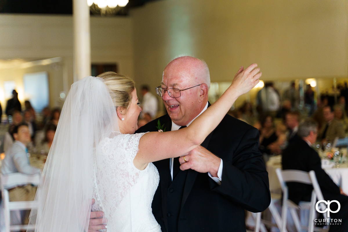 Bride sharing a dance with her father.