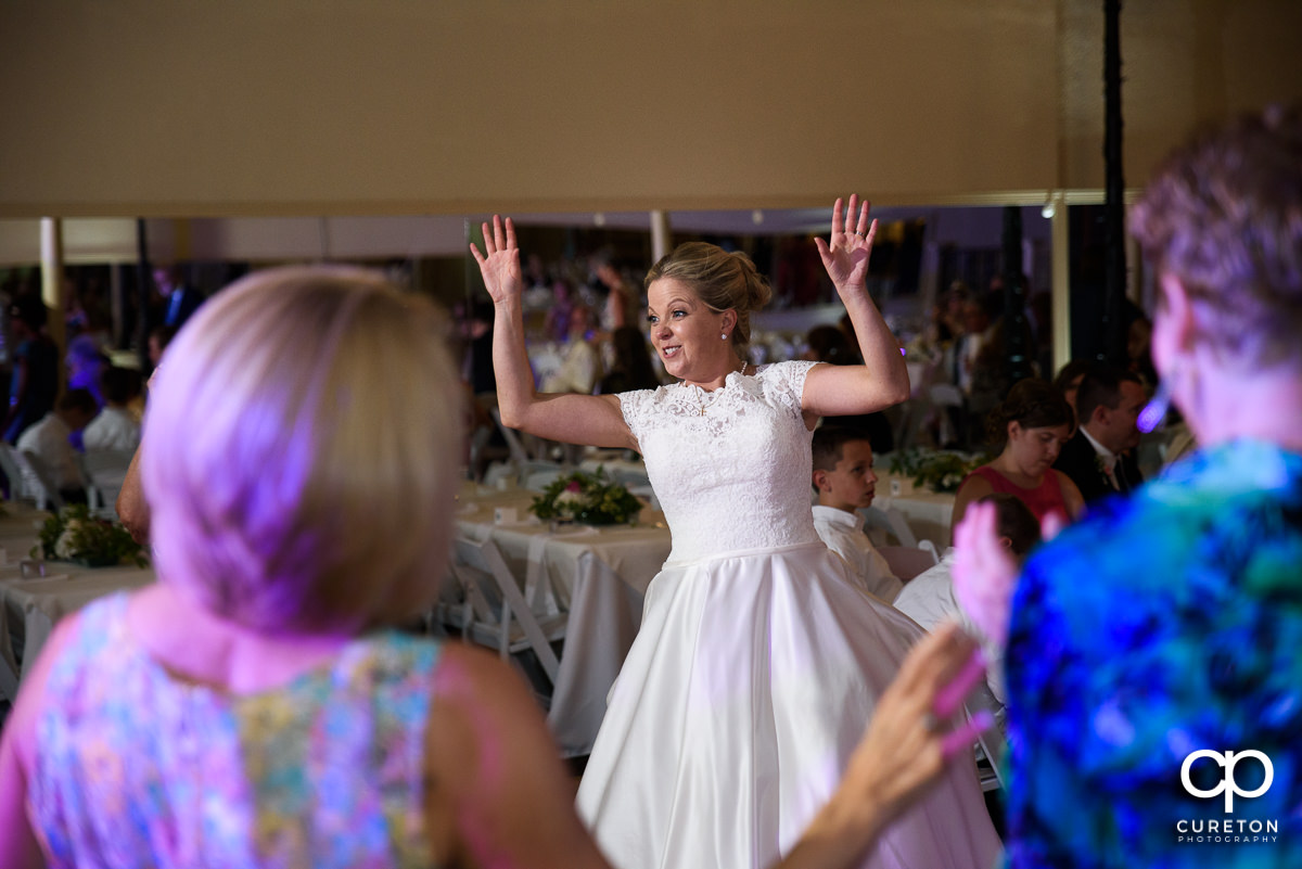 Guests dancing at the Grace Hall wedding reception to the sounds of DJ Sam from PPE Event Group.