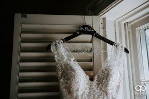 Bridal dress with custom hangar.