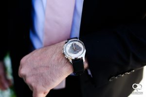 Groom showing off his new watch.