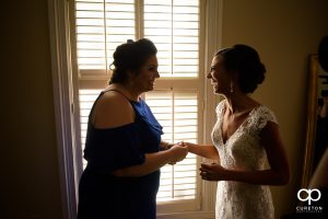 Bride laughing with her maid of honor.