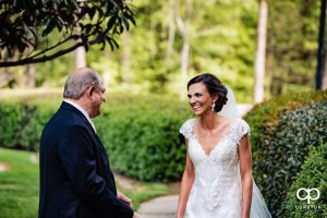 Bride's father seeing her for the first time in her dress on the wedding day.