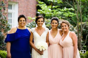 Bride and the bridesmaids outside of the chapel.
