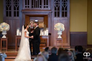 Bride and groom at the alter.