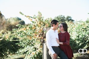 Engaged couple during their rustic farm engagement session near Greenville South Carolina.